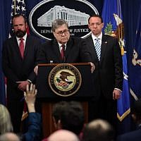 US Attorney General William Barr (C) takes questions about the release of the redacted version of the Mueller Report at the Department of Justice April 18, 2019 in Washington, DC. Also pictured (L-R) are Ed OCallaghan, Acting Principal Associate Deputy Attorney General and Deputy Attorney General Rod Rosenstein. (Win McNamee/Getty Images/AFP)