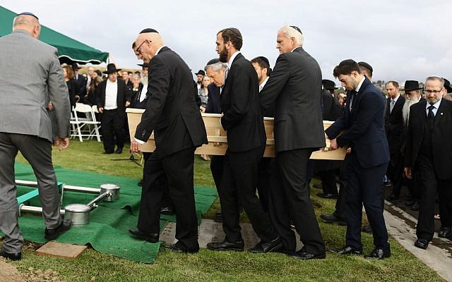 Pallbearers carry the casket of Poway synagogue shooting victim Lori Gilbert-Kaye during a graveside service on April 29, 2019, in San Diego, California. (Mario Tama/Getty Images/AFP)