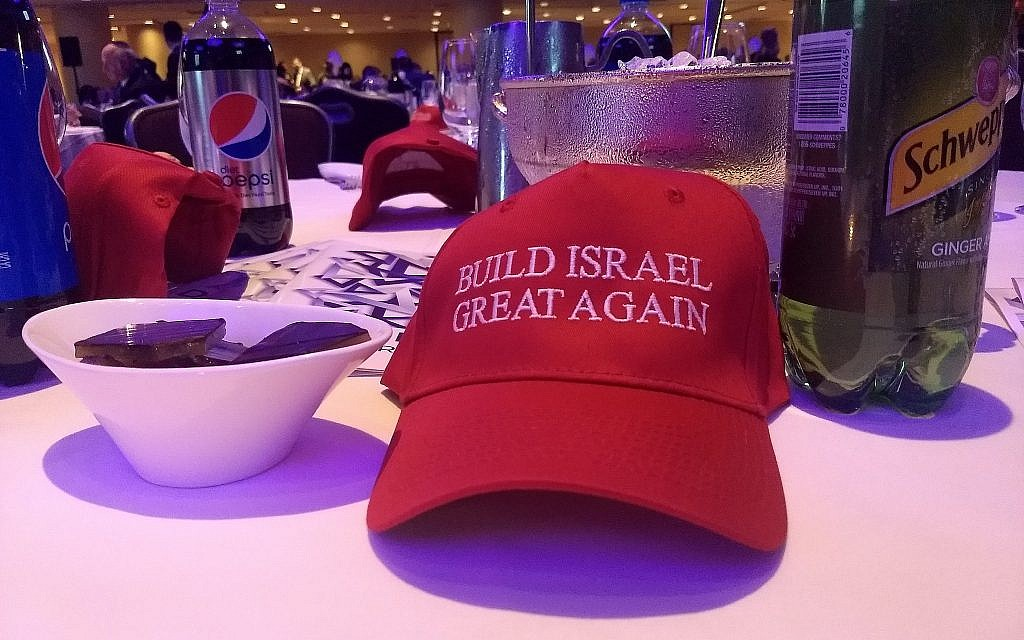 Each table at Young Israel's gala dinner was decorated by MAGA-style hats reading 'Build Israel great again.' (Ben Sales)