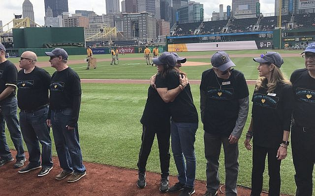 People with connections to the victims of the Pittsburgh synagogue and Parkland school shootings were honored at PNC Park in Pittsburgh before a game, April 6, 2019. (Mike Elk)