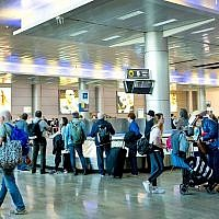 Illustrative: Travelers at Ben-Gurion Airport in Tel Aviv in 2018. (Moshe Shai/Flash90/File)