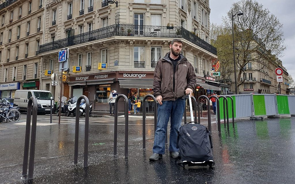 JTA's Cnaan Liphshiz, a Netherlands resident shown in Paris, is one of many native Israeli citizens abroad forced to travel to the Jewish state to vote in elections. (Courtesy of Liphshiz)