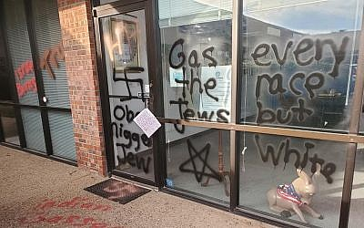 Anti-Semitic and racist graffiti spray-painted on a building in Oklahoma, April 3, 2019. (Facebook)