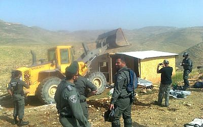 Border Police officers look on as a home in the illegal Maoz Esther outpost is demolished in the central West Bank on April 30, 2019. (Hilltop Youth L'hakeer Mekarov/Facebook)