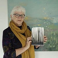 "Elly Wright, a Dutch painter who has lived in Britain for 51-years, poses for photographs with a copy of the book ""In Limbo"", in which her Brexit testimonial story is one of those featured, at her home in Epsom, on the south west edge of London, Wednesday, April 10, 2019. Britain's seemingly endless debate over leaving the European Union has brought division, strife and fear of foreigners, and the trauma has shattered Wright's sense of belonging. (AP Photo/Matt Dunham)"
