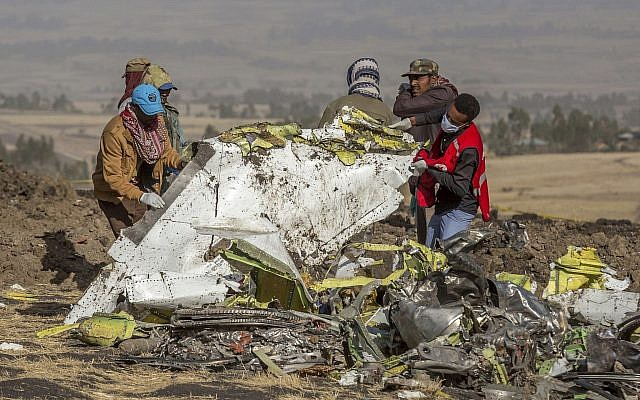 In this March 11, 2019, file photo, rescuers work at the scene of an Ethiopian Airlines flight crash near Bishoftu, Ethiopia. (AP Photo/Mulugeta Ayene, File)