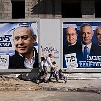 "People walk by election campaign billboards showing Prime Minister Benjamin Netanyahu, left, alongside Blue and White party leaders, from left to right, Moshe Ya'alon, Benny Gantz, Yair Lapid and Gabi Ashkenazi, in Tel Aviv, April 3, 2019. Hebrew on billboards reads, left, ""A strong Likud, a strong Israel,"" and on the right, ""Every vote counts, Blue and White victory."" (AP Photo/Oded Balilty)"