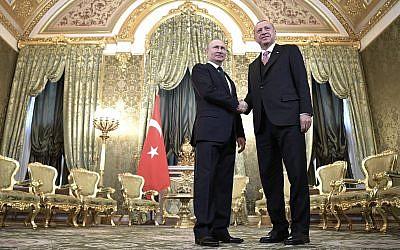 Russian President Vladimir Putin, left, and Turkish President Recep Tayyip Erdogan during their meeting in the Kremlin in Moscow, Russia, April 8, 2019.  (Alexei Nikolsky, Sputnik, Kremlin Pool Photo via AP)
