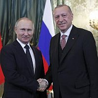 Russian President Vladimir Putin, left, shakes hands with Turkish President Recep Tayyip Erdogan during their meeting in the Kremlin in Moscow, Russia, Monday, April 8, 2019. (Maxim Shipenkov/Pool Photo via AP)