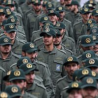 In this Feb. 11, 2019 file photo, Iranian Revolutionary Guard members attend a ceremony celebrating the 40th anniversary of the Islamic Revolution, at the Azadi, or Freedom, Square in Tehran, Iran.  (AP Photo/Vahid Salemi)