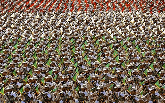 Members of Iran's Revolutionary Guard march during an annual military parade at the mausoleum of Ayatollah Khomeini, outside Tehran, Iran, on September 22, 2014. (AP Photo/Ebrahim Noroozi)