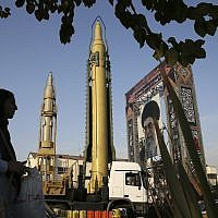 In this September 24, 2017 file photo, surface-to-surface missiles and a portrait of the Iranian Supreme Leader Ayatollah Ali Khamenei are displayed by the Revolutionary Guard. (AP Photo/Vahid Salemi)