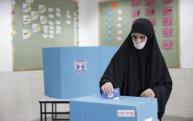 A Bedouin Israeli woman votes in the southern city of Rahat, Tuesday, April 9, 2019. (AP Photo/Tsafrir Abayov)