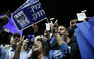 Likud party supporters cheer at the party's campaign headquarters after polls close in Knesset elections, in Tel Aviv, in the early hours of April 10, 2019. (AP Photo/Ariel Schalit)