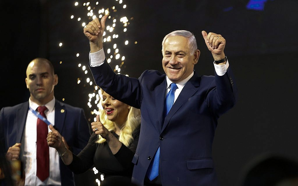 Prime Minister Benjamin Netanyahu waves to supporters at a victory celebration after polls for general elections closed in Tel Aviv, April 9, 2019. (AP Photo/Ariel Schalit)