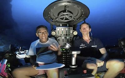 An image taken from video issued by Nekton shows Seychelles President Danny Faure, left, speaking from inside a submersible from the vessel Ocean Zephyr, under the water off the coast of Desroches, in the outer islands of Seychelles, April 14, 2019. (Nekton via AP)