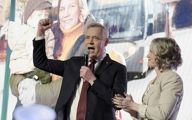 Chairman of the Finnish Social Democratic Party Antti Rinne speaks with his wife Heta Ravolainen-Rinne, right, at the parliamentary election party in Helsinki, Sunday, April 14, 2019.  (Antti Aimo-Koivisto/Lehtikuva via AP)