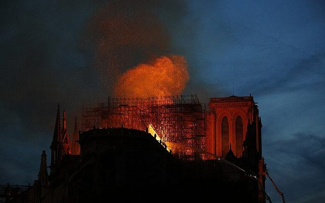 Firefighters use hoses as Notre Dame cathedral burns in Paris, Monday, April 15, 2019 (AP Photo/Francois Mori)