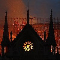 Flames and smoke rise from Notre Dame cathedral, as it burns in Paris, on April 15, 2019. (AP Photo/Thibault Camus)