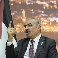 Palestinian Authority Prime Minister Mohammad Shtayyeh talks during an interview with The Associated Press, at his office in the West Bank city of Ramallah, Tuesday, April 16, 2019. (AP Photo/Nasser Nasser)