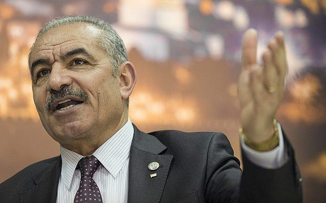 Palestinian Authority Prime Minister Mohammad Shtayyeh talks during an interview with The Associated Press, at his office in the West Bank city of Ramallah, April 16, 2019. (AP Photo/Nasser Nasser)