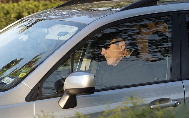 Special counsel Robert Mueller drives away from his Washington home on April 17, 2019. (AP Photo/Kevin Wolf)