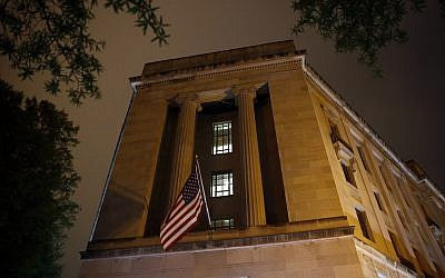 An American flag flies outside the Department of Justice on April 18, 2019, in Washington. (AP Photo/Patrick Semansky)