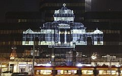 The Great Synagogue of Warsaw, which was destroyed by the German forces during World War II, was recreated virtually with light as part of anniversary commemorations of the 1943 uprising in the Warsaw Ghetto, in Warsaw, Poland, Thursday, April 18, 2019. The multimedia installation, which included the archival recordings of a prewar cantor killed in the Holocaust, is the work of Polish artist Gabi von Seltmann. It was organized by a group that fights anti-Semitism. (AP Photo/Czarek Sokolowski)