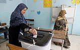 A voter casts her ballot at polling station in Cairo, Egypt, April 21, 2019 on constitutional amendments that would allow President Abdel-Fattah el-Sissi to stay in power until 2030. (AP/Amr Nabil)