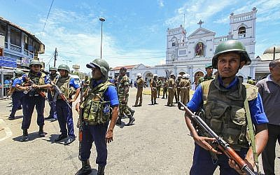 Sri Lankan Army soldiers secure the area around St. Anthony Shrine after a blast in Colombo, Sri Lanka, Sunday, April 21, 2019 (AP Photo/Chamila Karunarathne)