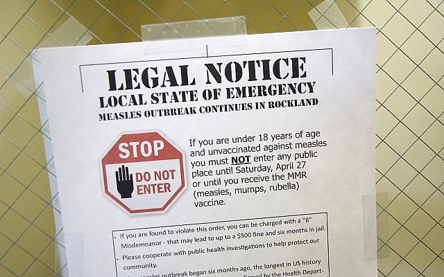 A notice explainis the local state of emergency because of a measles outbreak at the Rockland County Health Department in Pomona, New York, on March 27, 2019. (AP Photo/Seth Wenig)