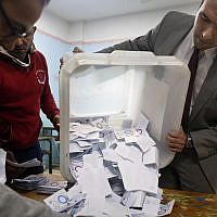 Election workers count ballots at the end of a referendum on constitutional amendments at a polling station in Cairo, Egypt, on April 22, 2019. (AP Photo/Amr Nabil)