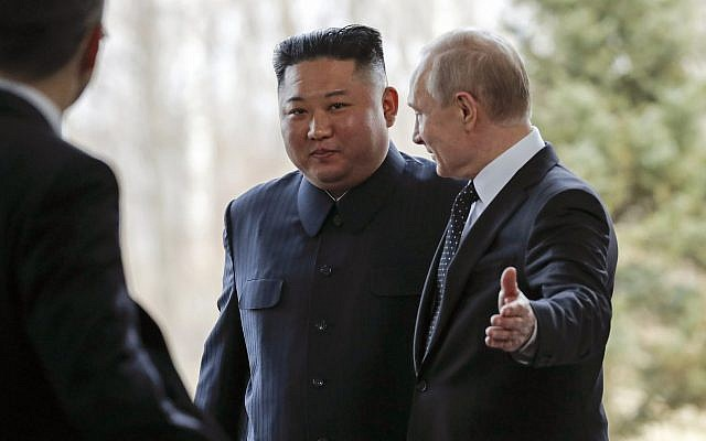 Russian President Vladimir Putin (right) welcomes North Korea's leader Kim Jong Un during their meeting in Vladivostok, Russia, on April 25, 2019. (AP/Alexander Zemlianichenko, Pool)