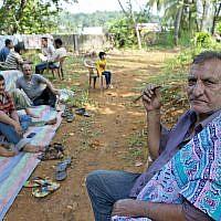 Ahmadi Muslim refugees eat a meal at a community center that they took refuge in Pasyala, north east of Colombo, Sri Lanka on April 25, 2019. (AP Photo/Gemunu Amarasinghe)
