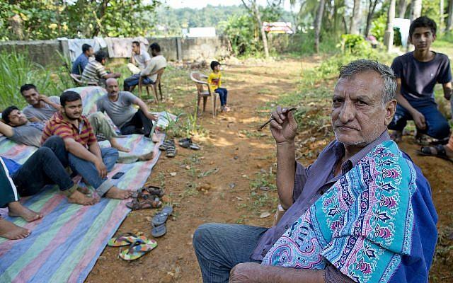 Ahmadi Muslim refugees at a community center where they took refuge in Pasyala, northeast of Colombo, Sri Lanka, on April 25, 2019. (AP/Gemunu Amarasinghe)