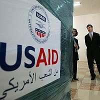 US consul general in Jerusalem Jacob Walles (2nd R) looks at USAID donations donated to the Palestinians in the west Bank town of Ramallah on May 10, 2006. (AP Photo/Muhammed Muheisen)