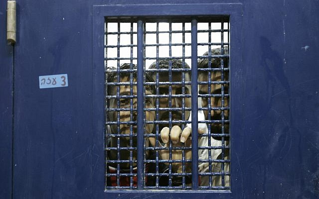 Illustrative: Palestinian prisoners stand in a cell, pending their release from Ketziot prison in southern Israel, on October 1, 2007. (AP Photo/Ariel Schalit/File)