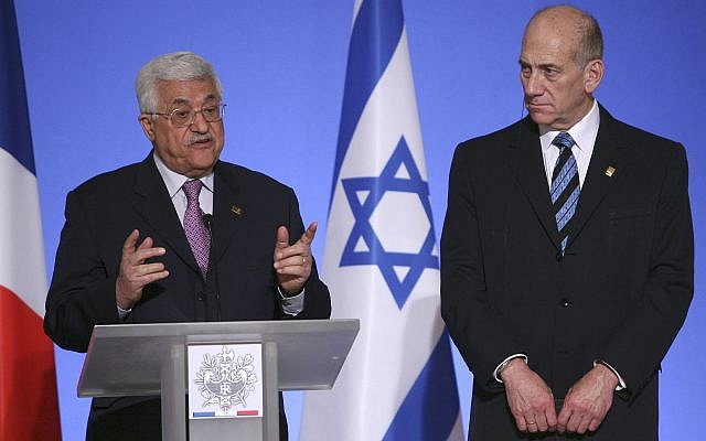 Palestinian Authority President Mahmoud Abbas, left, speaks while Israel's Prime Minister Ehud Olmert, right, looks on during a media conference at the Elysee Palace in Paris, Sunday July 13, 2008. (AP Photo/Jacques Brinon)