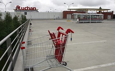 In this July 12, 2009 file, the empty parking lot of an Auchan hypermarket is seen in Plaisir, France. (AP Photo/Remy de la Mauviniere, File)