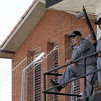 Corrections officers keep watch from a guard tower outside the Texas Department of Criminal Justice Huntsville Unit before the scheduled execution of Lawrence Russell Brewer, Sept. 21, 2011, in Huntsville, Texas. (AP/David J. Phillip)
