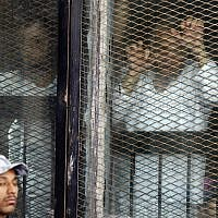 Illustrative: Defendants in Egypt listen to their verdict from a soundproof glass cage inside a makeshift courtroom in Tora prison in Cairo, Egypt, July 28, 2018. (AP Photo/Amr Nabil)