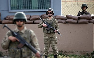 In this April 16, 2018 illustrative photo, members of Turkish forces guard the prison complex in Aliaga, Izmir province, western Turkey. (AP Photo/Lefteris Pitarakis, File)