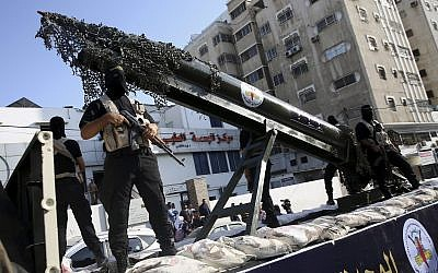 Palestinian members of the Al-Quds Brigades, the military wing of the Islamic Jihad terror group, parade with a replica rocket on a truck during a march in Gaza on October 4, 2018. (AP Photo/Adel Hana)