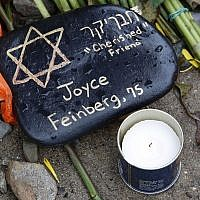 A stone at a makeshift memorial outside the Tree of Life Synagogue to the 11 people killed Oct 27, 2018 while worshipping in the Squirrel Hill neighborhood of Pittsburgh Nov. 1, 2018. (AP Photo/Gene J. Puskar)