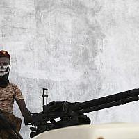 A Yemeni soldier stands guard in Mukalla, Yemen, Thursday, Nov. 29, 2018. (AP Photo/Jon Gambrell)