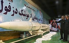 In this photo released Thursday, Feb. 7, 2019, by Sepahnews, the website of the Iranian Revolutionary Guard, Amir Ali Hajizadeh, chief of the Guard's aerospace division, left, explains the Dezful surface-to-surface ballistic missile to the Guard's chief, Mohammad Ali Jafari during an inauguration ceremony, in an undisclosed location, Iran. (Sepahnews via AP)