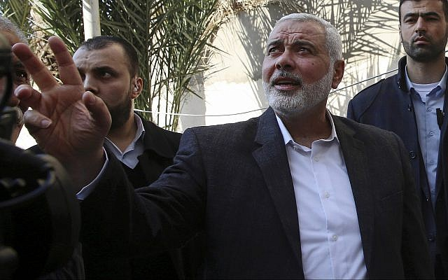 Hamas leader Ismail Haniyeh tours the site of a destroyed building, in Gaza City, March 27, 2019. (AP Photo/Adel Hana)