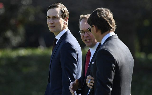 White House adviser Jared Kushner, left, walks with acting White House chief of staff Mick Mulvaney, center, and White House Deputy Press Secretary Hogan Gidley, toward Marine One on the South Lawn of the White House in Washington, March 28, 2019. (AP/Susan Walsh)