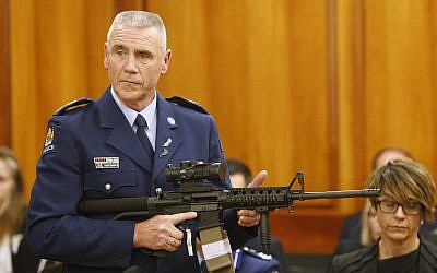 Police Sr. Sgt. Paddy Hannan shows New Zealand lawmakers in Wellington, April 2, 2019, an AR-15 style rifle similar to one of the weapons a gunman used to kill 50 people at two mosques. (AP/Nick Perry)