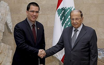 Venezuelan Foreign Minister Jorge Arreaza, (left), shakes hands with his Lebanese counterpart, Gebran Bassil, in Beirut, April 3, 2014. (Dalati Nohra via AP)